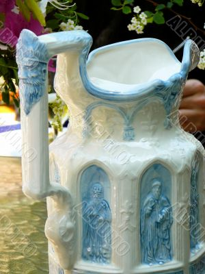 Elaborate ceramic water pitcher