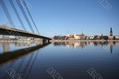 Old Town Panorama with River and Bridge Fragment in Sunny Day