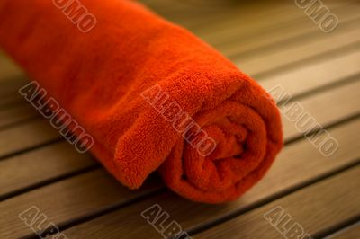 towel braided  in a tubule on chair