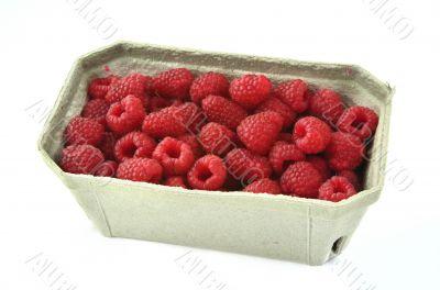 raspberries in cardboard box