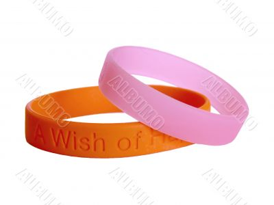 Silicone wristbands together orange and pink