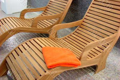 Sunbeds in the fitness with one orange towel