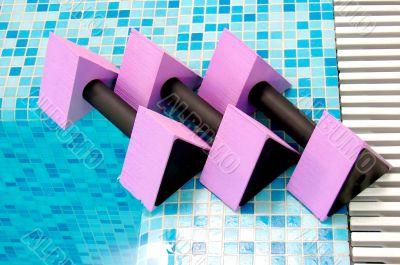 three pink aqua dumbbells