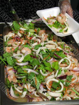 Chef serving seafood salad