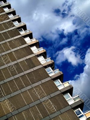 Tower block and cloudy blue sky