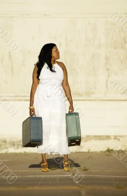 African American woman with suitcases.