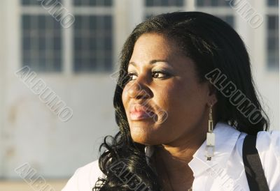 African American Woman close up in front of Hangar