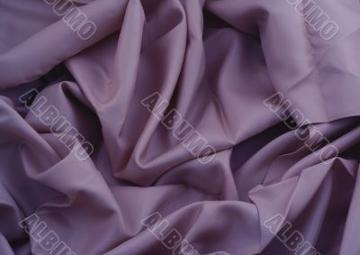 close-up of creased purple satin