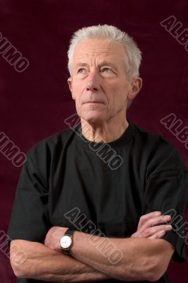 Serious looking older man casually dressed