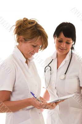 Nurses checking out the notes