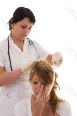 Nurse bandaging a patient