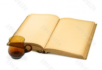 open blank book with teacup