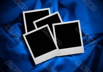 photo frames against textile background