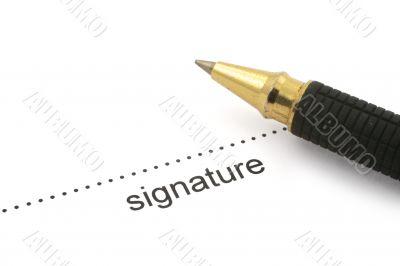 signature and ballpoint pen