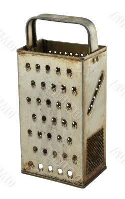old rusty grater on white
