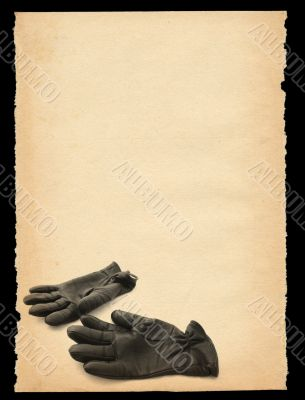 torn out old sheet of paper with gloves motif