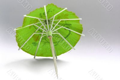 close-up of green cocktail umbrella