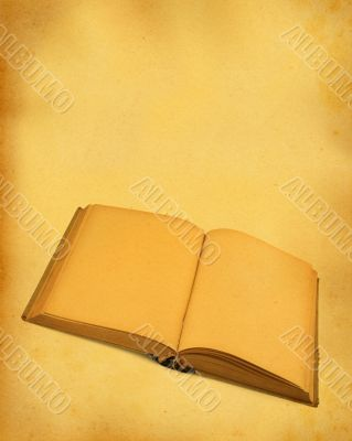 open blank book against stained dirty paper