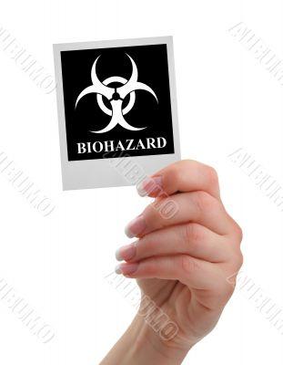 hand holding biohazard warning