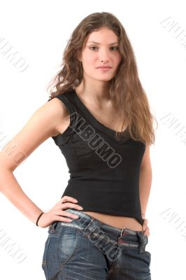 Beautiful teenager standing with hands on her hips