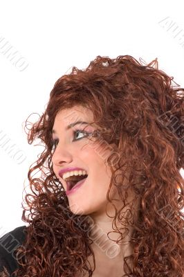 Beautiful teenager wearing a curly wig