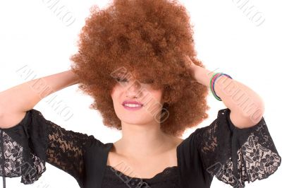Pretty teenager with afro wig