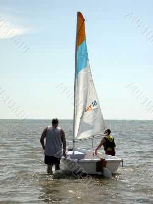 father and son with sailboat