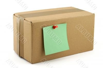 cardboard box with pinned note