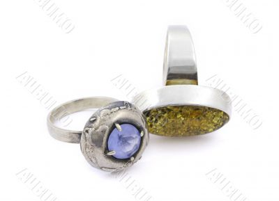 two aged rings with gems on white