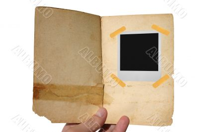 aged open book  with polaroid frame