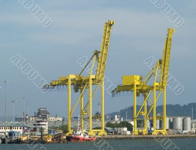 Two container cranes in a harbour