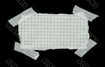 squared strip of paper with white plaster pieces