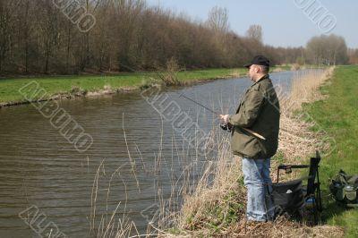Fisherman by the waterside