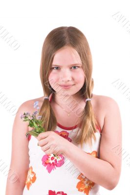 Pretty little girl holding a few forget-me-nots