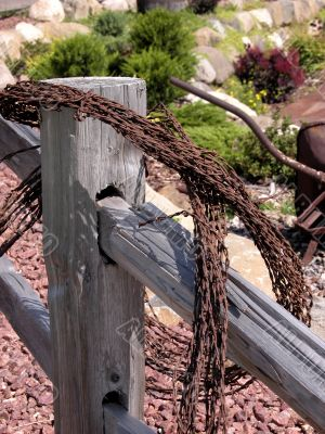 Rusted wire on fence