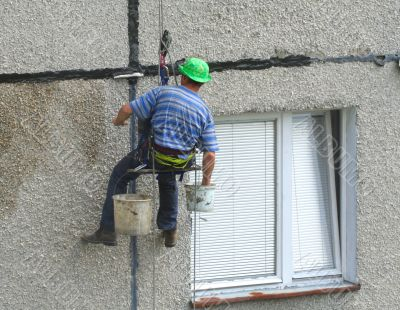 renovation worker on a block of flats