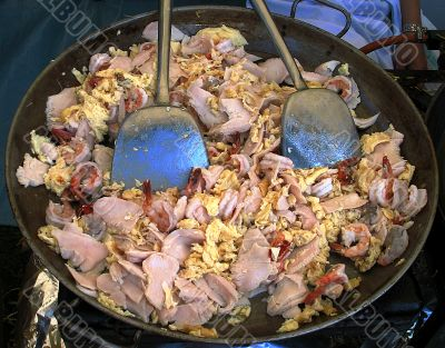 Wok with meat eggs and fish