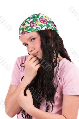 Shy ten year old girl wearing a bandana