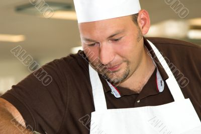Italian chef working concentrated