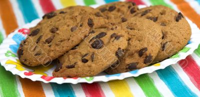 Chocolate chip cookies on colourful background