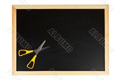 Chalkboard with yellow scissors