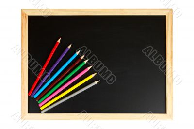 Chalkboard and multicolored pencils
