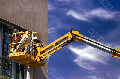 Worker on a high lift