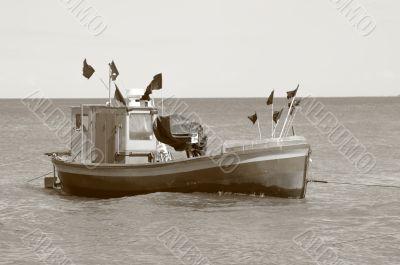 old fisging boat - sepia tone