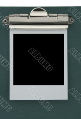 empty photo frame stuck to a clipboard