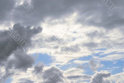 massive stormy clouds against bright blue sky