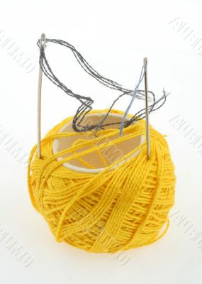 yellow thread and needles on white