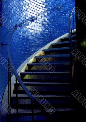 Spiral staircase and stark blue walls