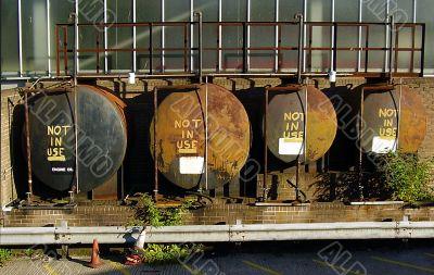 A row of four oil storage tanks