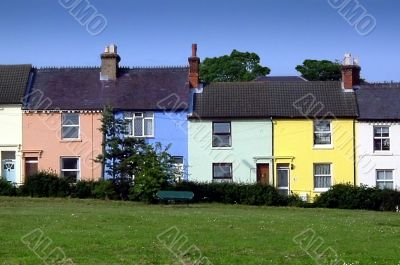 row of village houses painted in pastel colours